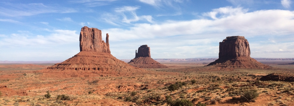 Three buttes in Monument Valley Tribal Park are seen in the distance