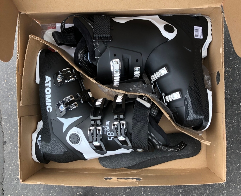 Pair of ski boots in a box